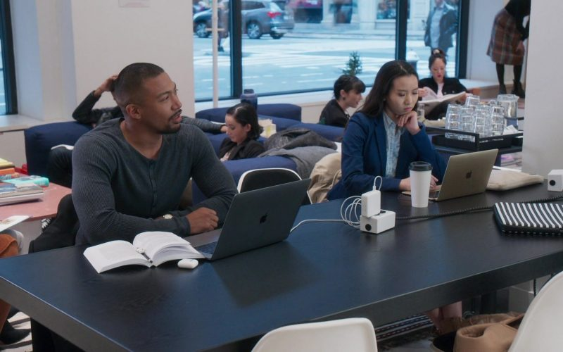 Charles Michael Davis et al. sitting at a table with a laptop