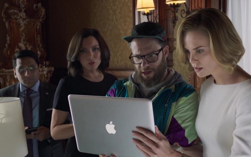 Apple MacBook Notebook Held by Charlize Theron in Long Shot (2)