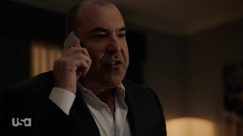 Rick Hoffman wearing a suit and tie