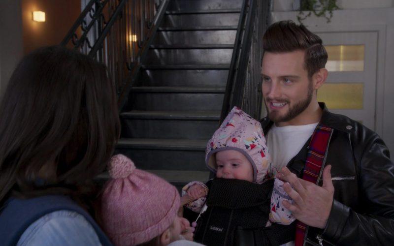 Nico Tortorella holding a baby