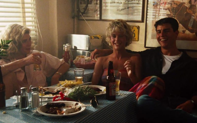 Tom Cruise et al. sitting at a table with food