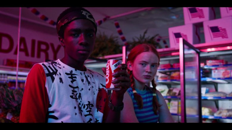 Caleb McLaughlin, Sadie Sink are posing for a picture