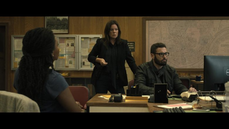 Marcia Gay Harden et al. sitting at a table
