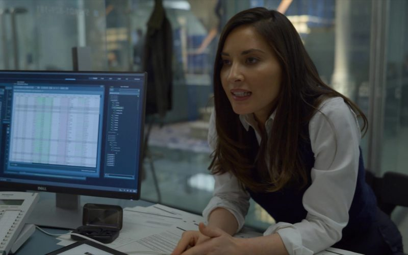 Olivia Munn sitting at a desk in front of a laptop computer