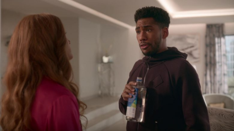 Fiji Bottled Water Held by Brandon Mychal Smith in Four Weddings and a Funeral - Season 1, Episode 1, Kash With a K (2019) - TV Show Product Placement