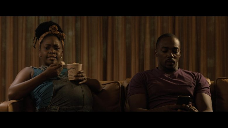 Teyonah Parris, Anthony Mackie sitting on a table