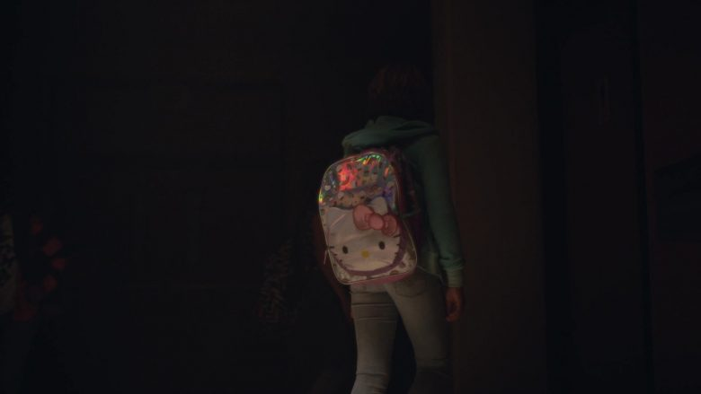 A girl standing in a dark room