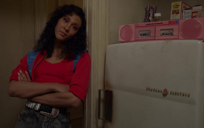 Mj Rodriguez standing in front of a refrigerator