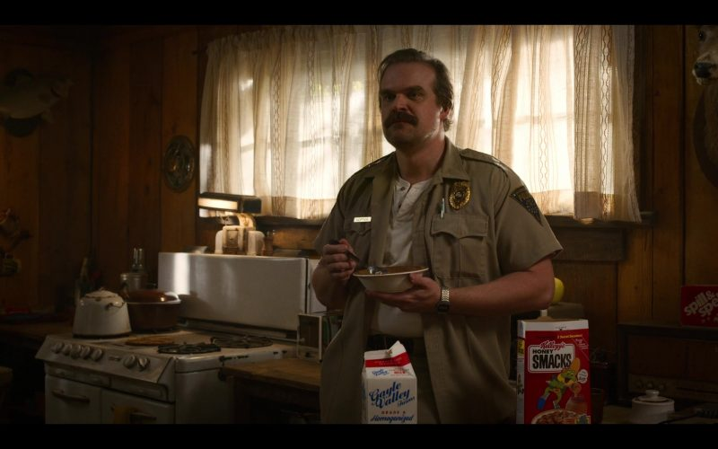 David Harbour standing in a kitchen preparing food