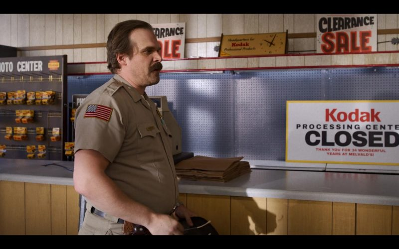 David Harbour standing in front of a counter
