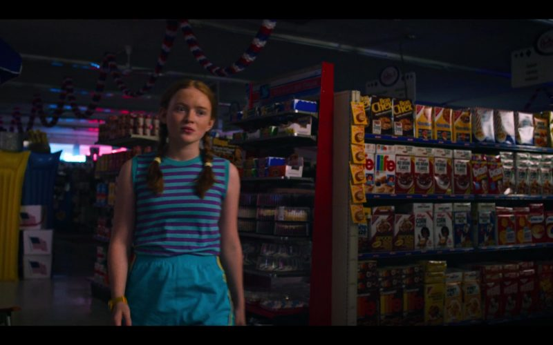 Sadie Sink standing in front of a store