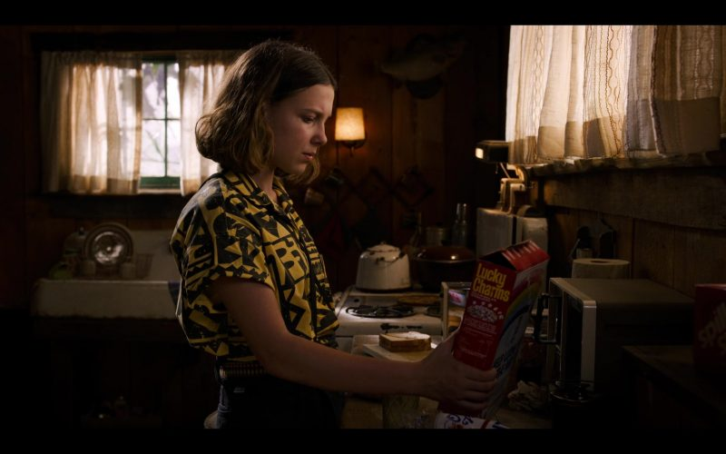 Millie Bobby Brown standing in a kitchen