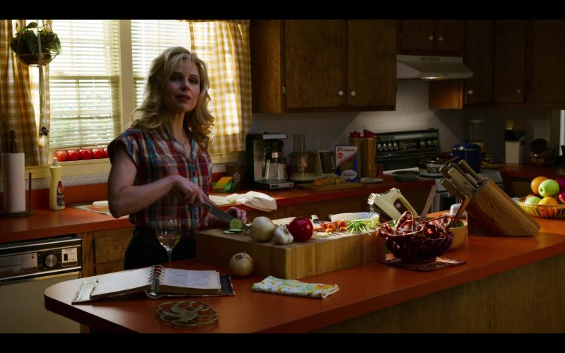 Cara Buono standing in a kitchen preparing food