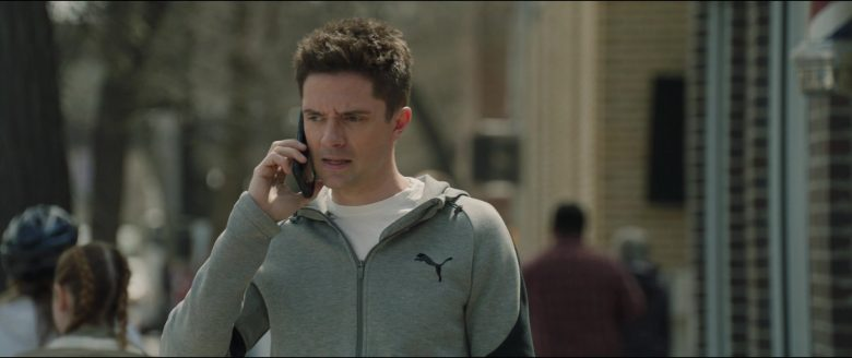 Topher Grace talking on a cell phone