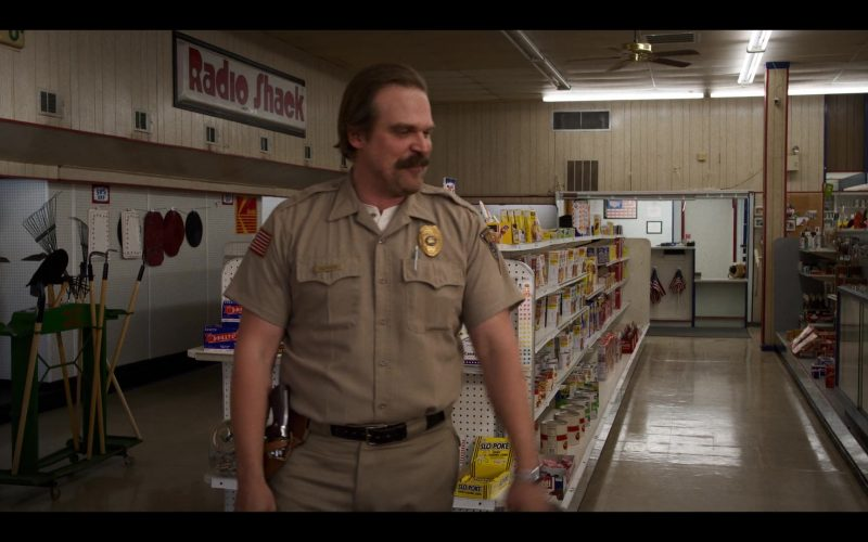 David Harbour standing in a store