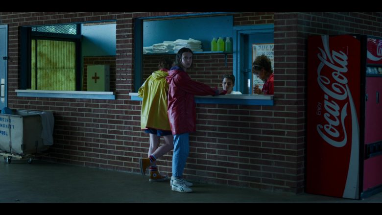 "Reebok Sneakers Worn by by Millie Bobby Brown, Converse Shoes Worn by Sadie Sink and Coca-Cola Vending Machine in Stranger Things - Season 3, Episode 3, ""The Case of the Missing Lifeguard"" (2019) - TV Show Product Placement"