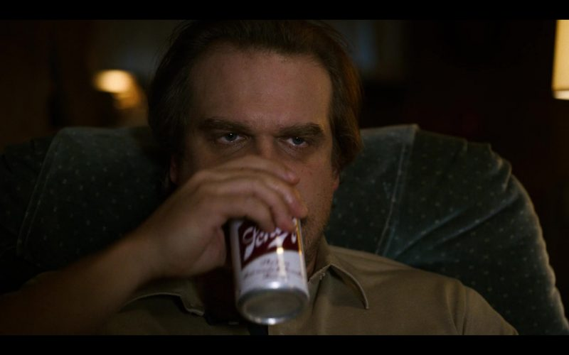 A man drinking from a glass