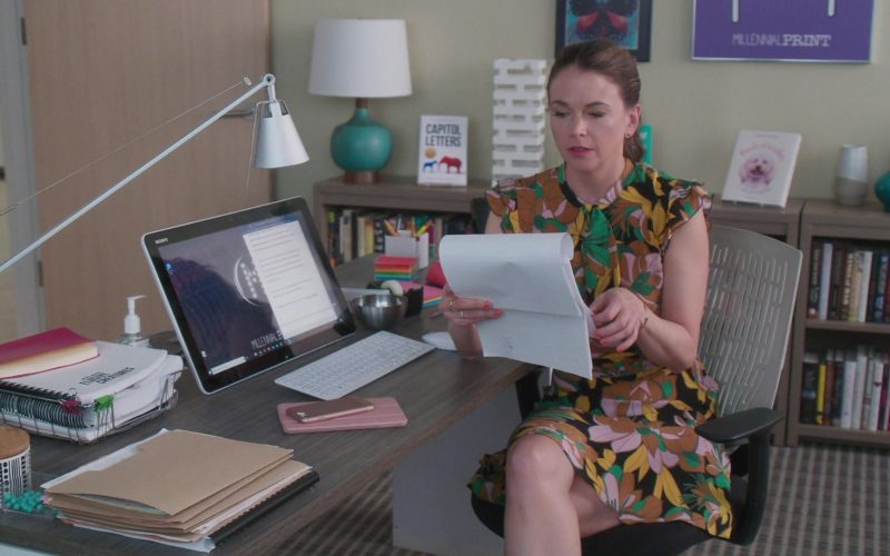 Sutton Foster sitting at a desk with a computer