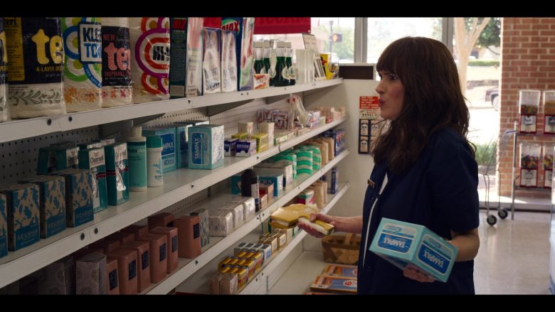 A person standing in front of products
