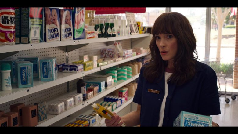 Winona Ryder standing in front of products