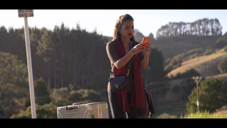 Apple iPhone XR Orange Coral Mobile Phone Used by Christina Milian in Falling Inn Love (2019) - Movie Product Placement