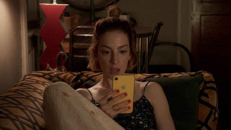 Apple iPhone XR Yellow Mobile Phone Held by Molly Kate Bernard in Younger - Season 6, Episode 10, It's All About the Money, Honey (2019) - TV Show Product Placement