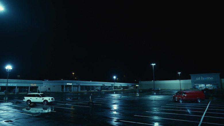 A boat docked at night