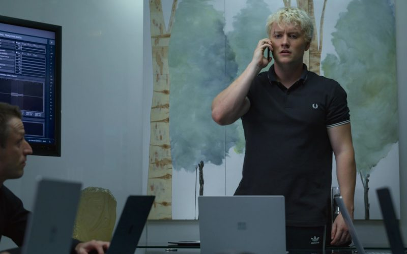 Fred Perry Shirt and Adidas Pants Worn by Jon Fletcher and Microsoft Surface Notebooks in The Rook