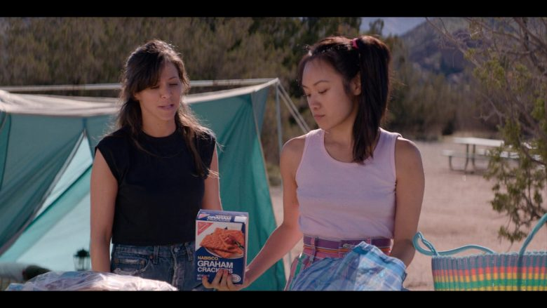 """Nabisco Graham Crackers Held by Ellen Wong as Jenny 'Fortune Cookie' Chey in Glow - Season 3, Episode 6, """"Outward Bound"""" (2019) - TV Show Product Placement"""