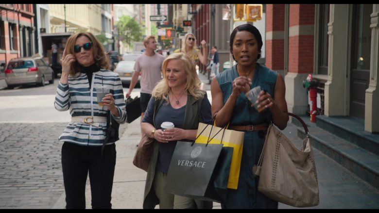 Versace Black Store Paper Bag Held by Angela Bassett in Otherhood (2019) - Movie Product Placement