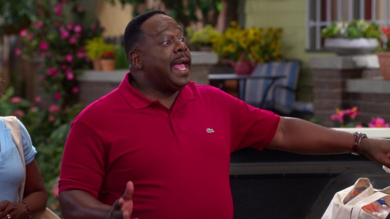 Lacoste Red Polo Shirt Worn by Cedric the Entertainer as Calvin Butler in The Neighborhood (1)