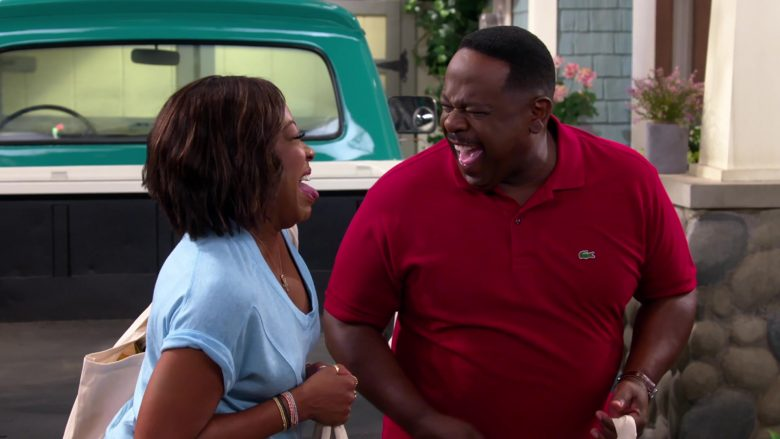 Lacoste Red Polo Shirt Worn by Cedric the Entertainer as Calvin Butler in The Neighborhood (5)