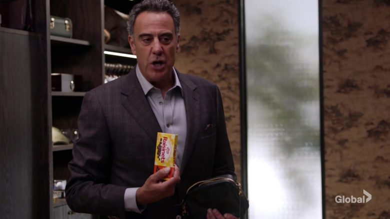 Nestle Raisinets Candy Held by Brad Garrett as Douglas Fogerty in Single Parents Season 2 Episode 5