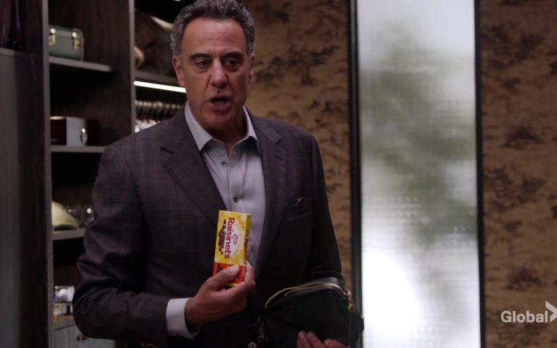 Nestle Raisinets Candy Held by Brad Garrett as Douglas Fogerty in Single Parents Season 2 Episode 5