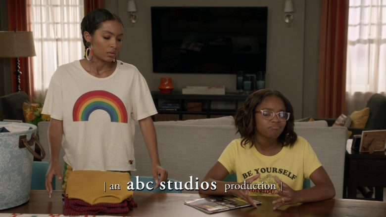 "New Balance T-Shirt Rainbow Print Worn by Yara Shahidi as Zoey Johnson in Black-ish Season 6, Episode 3 ""Feminisn't"" (2019) - TV Show Product Placement"