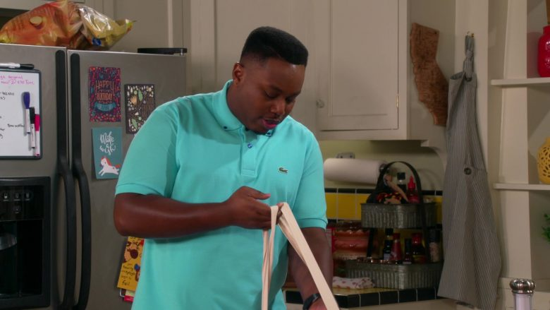 "Lacoste Polo Shirt Worn by Marcel Spears as Marty in The Neighborhood Season 2 Episode 7 ""Welcome to the Vow Renewal"" (2019) TV Show"
