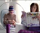 Billboard Magazine Held by Missi Pyle in Josie and the Pussy...