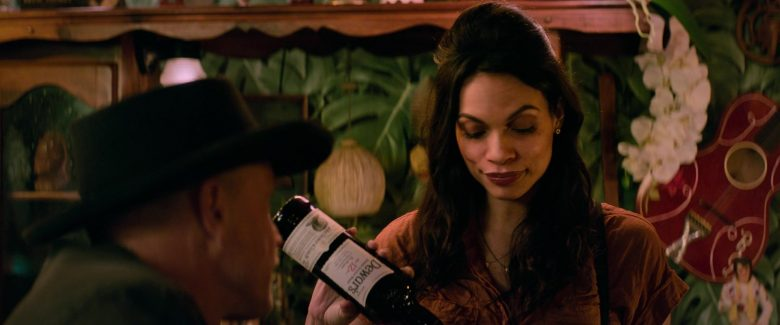 Dewar's 12 Year Aged Scotch Whisky Bottle Held by Rosario Dawson as Nevada in Zombieland Double Tap (1)