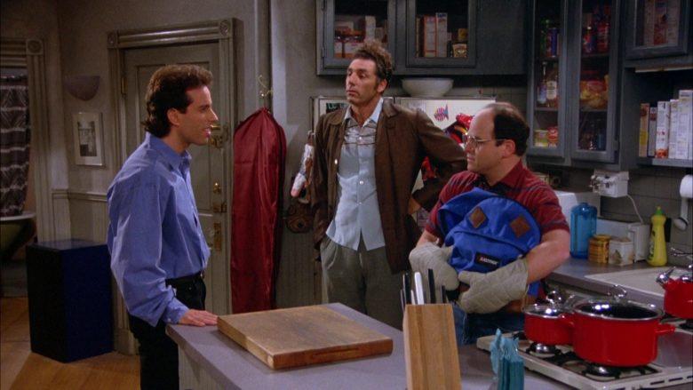 Eastpak Blue Backpack Held by Jason Alexander as George Costanza in Seinfeld Season 5 Episode 2 (1)