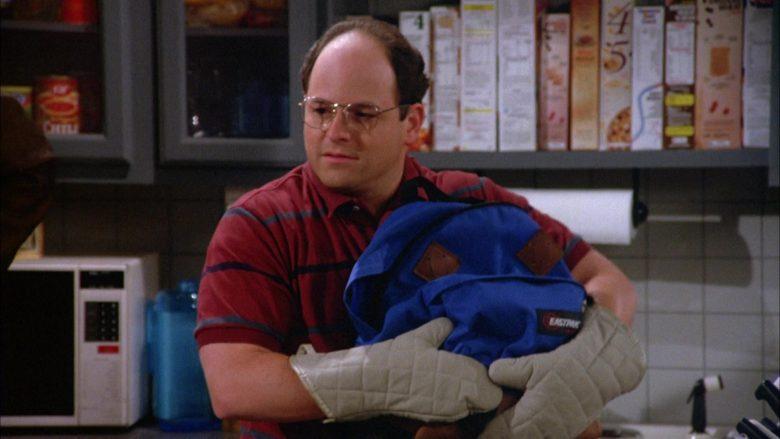 Eastpak Blue Backpack Held by Jason Alexander as George Costanza in Seinfeld Season 5 Episode 2 (2)