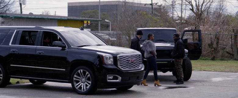 GMC Black SUV in Black and Blue (1)