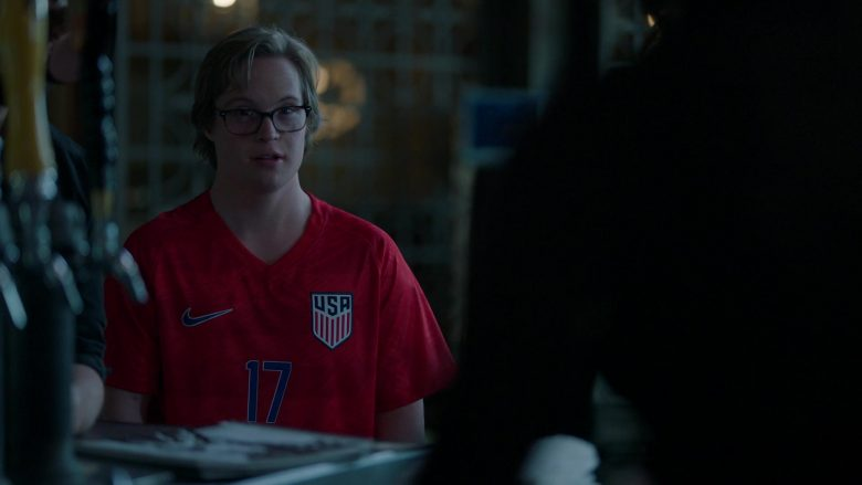 Nike Red T-Shirt Worn by Cole Sibus as Ansel Parios in Stumptown Season 1 Episode 8 (1)