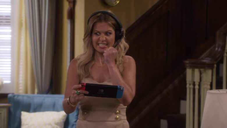 Nintendo Switch Console Held by Candace Cameron Bure as D.J. Tanner-Fuller in Fuller House Season 5 Episode 5 (5)