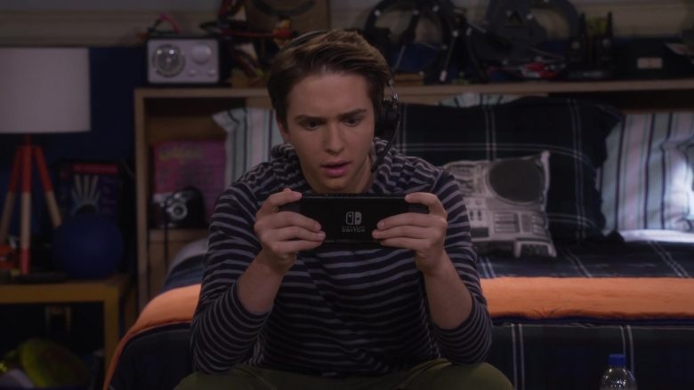 """Nintendo Switch Video Game Console Held by Michael Campion as Jackson in Fuller House Season 5 Episode 5 """"Ready Player Fuller"""" (2019) TV Show"""