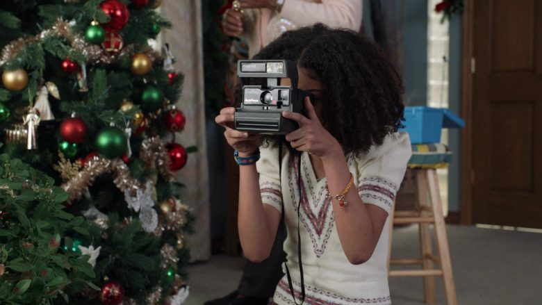 "Polaroid Camera Held by Arica Himmel as Rainbow 'Bow' Johnson in Mixed-ish Season 1 Episode 10 ""Do They Know It's Christmas?"" (2019) - TV Show Product Placement"