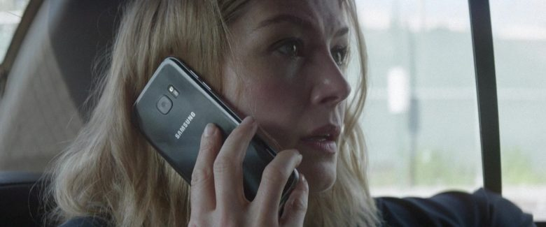 Samsung Galaxy Smartphone Used by Rosamund Pike in The Informer (2019) Movie