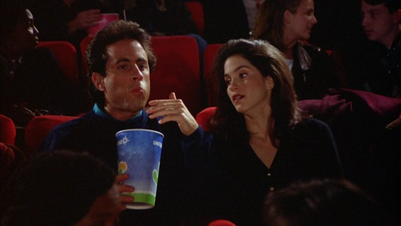 United Artists Cup Held by Jerry Seinfeld in Seinfeld Season 5 Episode 12 The Stall (1)