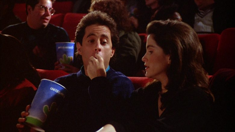 United Artists Cup Held by Jerry Seinfeld in Seinfeld Season 5 Episode 12 The Stall (2)