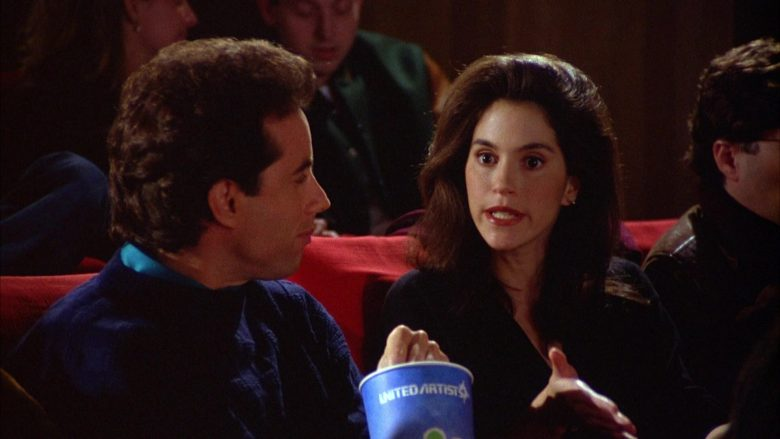 United Artists Cup Held by Jerry Seinfeld in Seinfeld Season 5 Episode 12 The Stall (5)