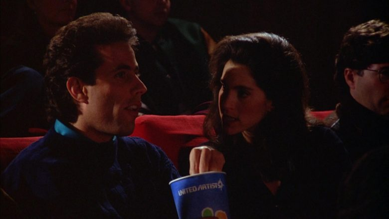 United Artists Cup Held by Jerry Seinfeld in Seinfeld Season 5 Episode 12 The Stall (6)
